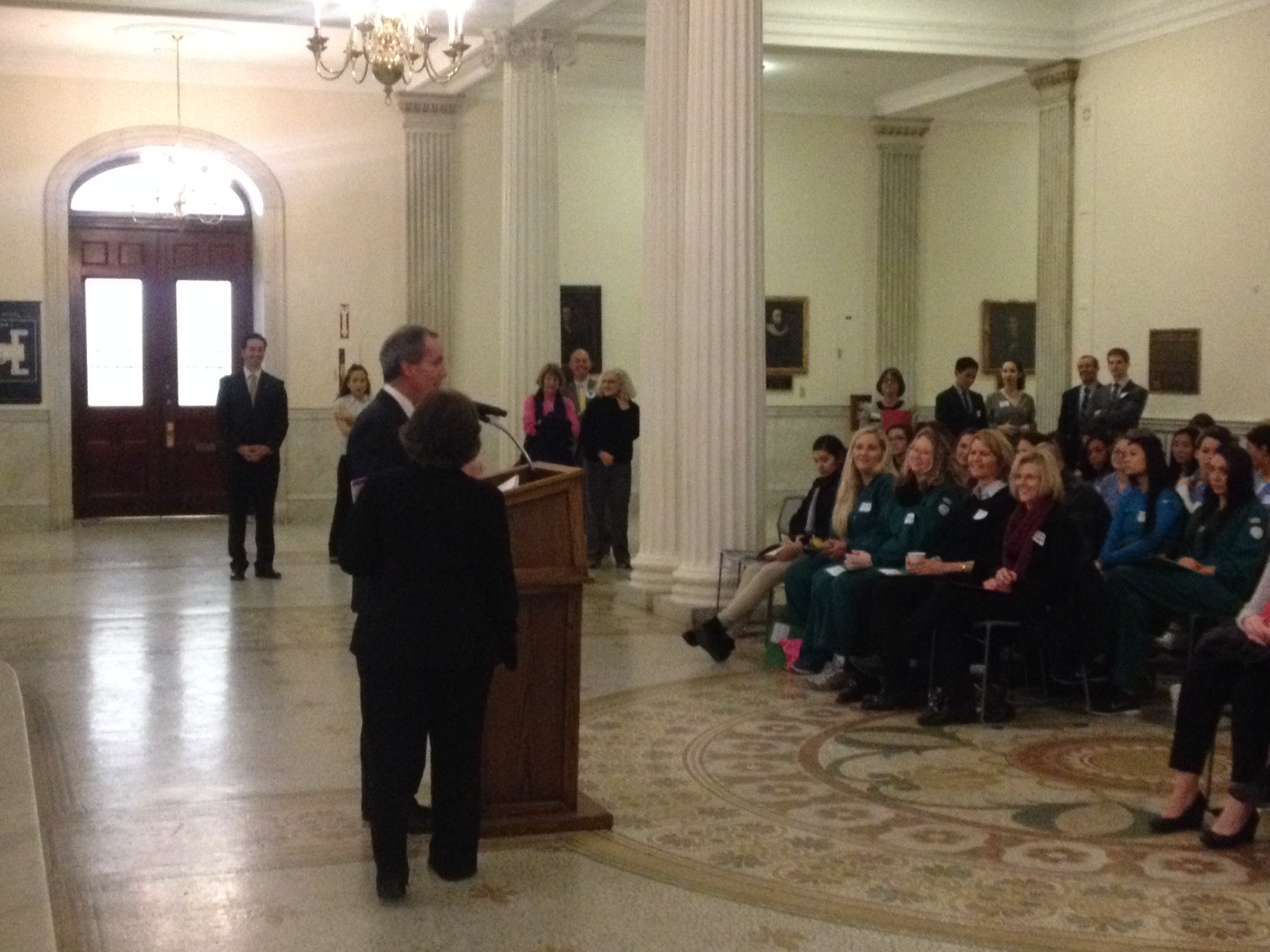 Representative Smitty Pignatelli addresses dental hygiene students at the State House