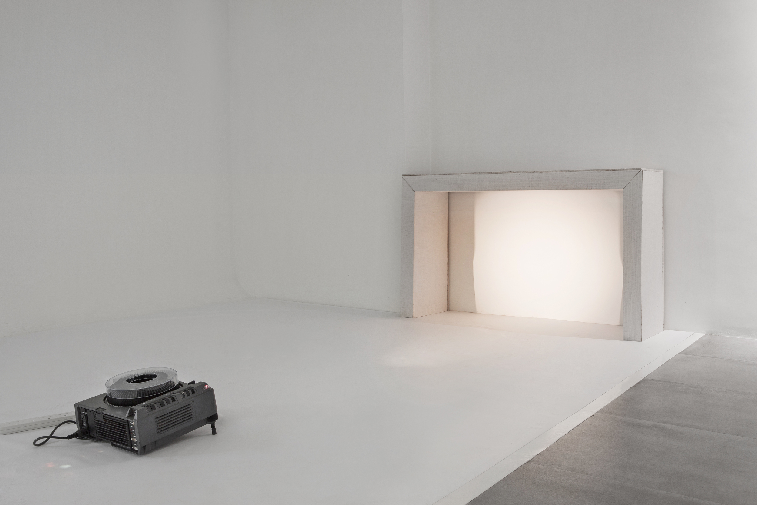 Fireplace (constructed)  , 150x90x40cm, fireproof wall, 35mm slide projection, 2014