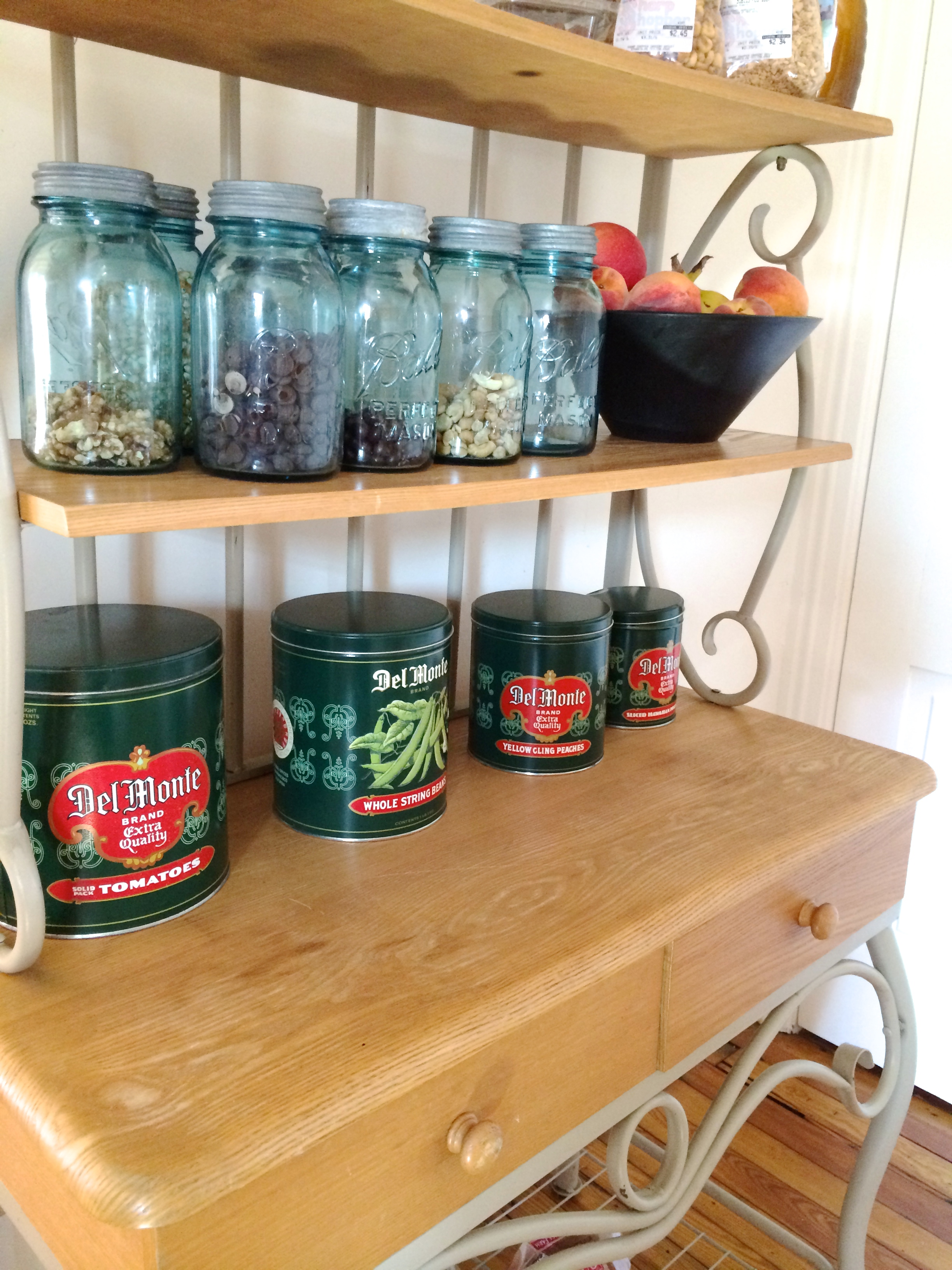 Bakers Rack with vintage Ball jars & tins