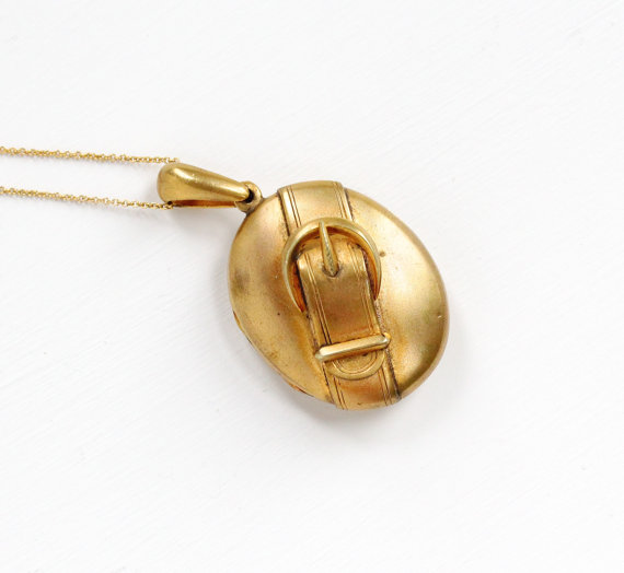 Antique Victorian Gold Toned Buckle Locket.
