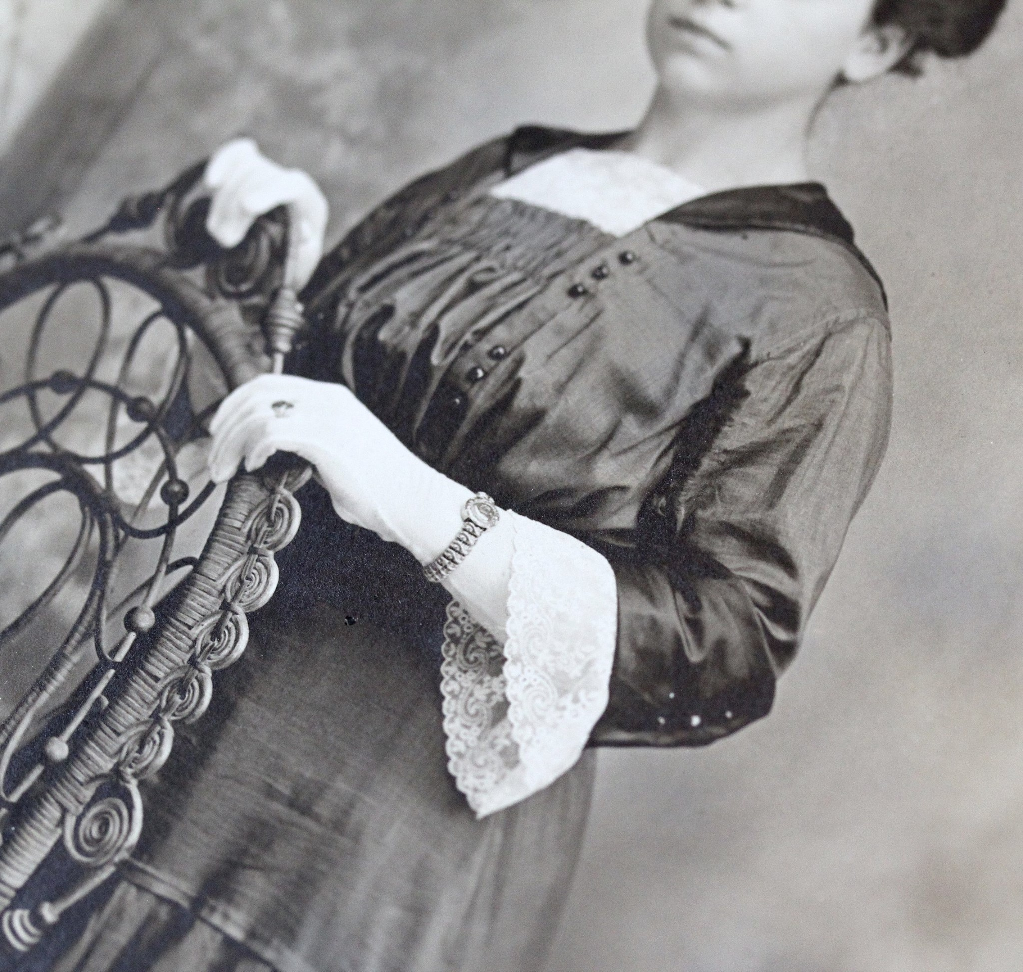 In addition to her expansion bracelet she is seen wearing a filigree ring on her gloved hand.