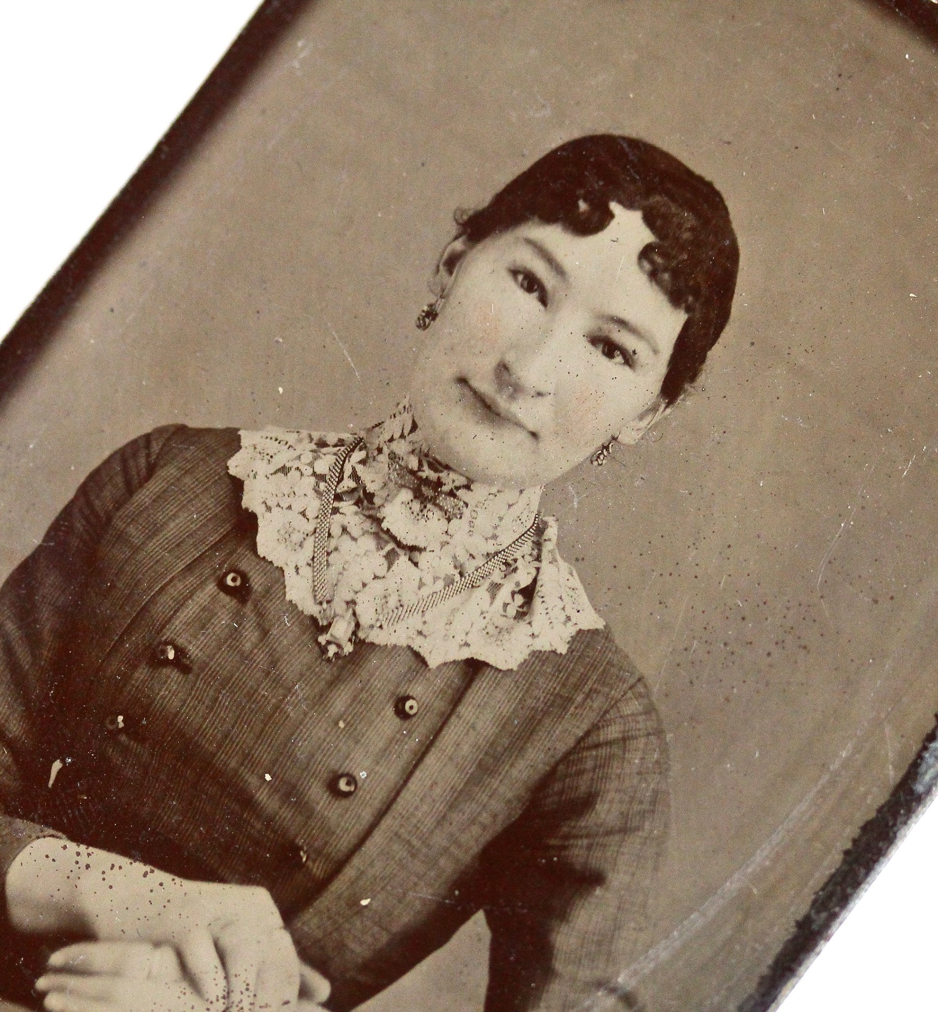 Victorian era tintype of an exotically alluring woman wearing a substantial book chain and dainty drop earrings.