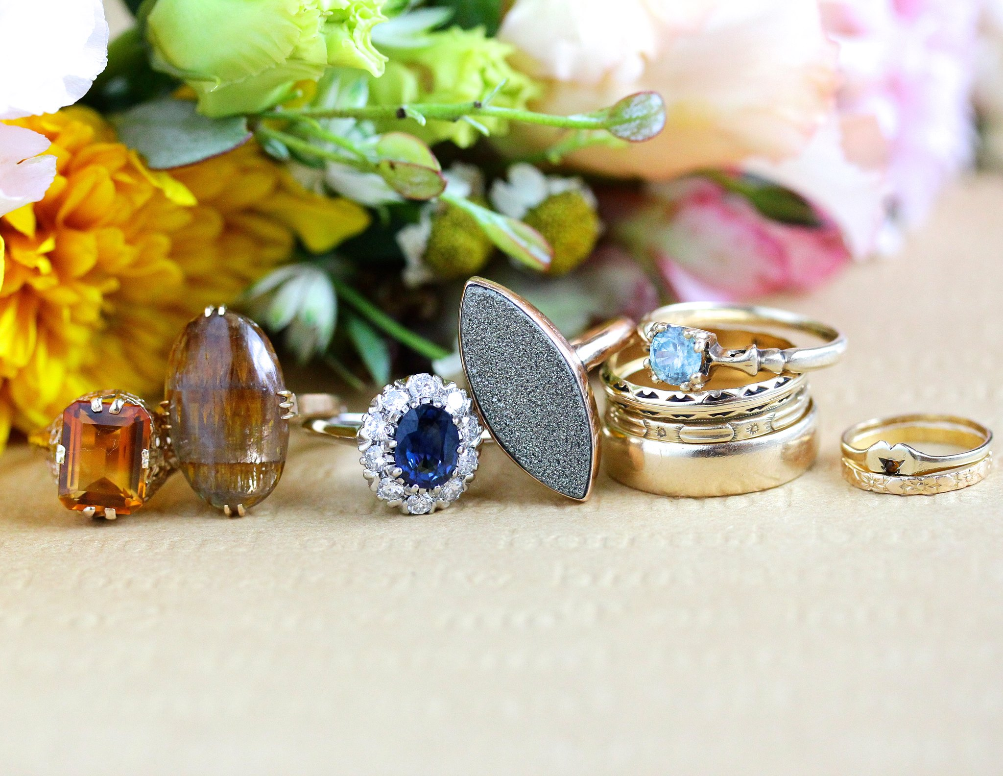 Vintage rings worn by Laura Mae, including:   Vintage 10k Rosy Yellow Gold Blue Zircon Ring     Vintage 18k Rosy Yellow Gold Rutilated Amethyst Quartz Ring