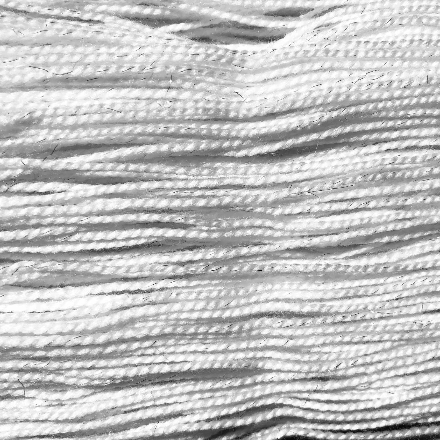 SPARKLE FINGERING - 75% Superwash Merino/20% Nylon/5% Stellina (silver-toned) // 438 yds/100 grAlso part of the 2-ply Fingering Family, this silver-toned subtle sparkle is soft enough to wear directly against the skin. Try mixing a skein into a larger project for some added dimension!