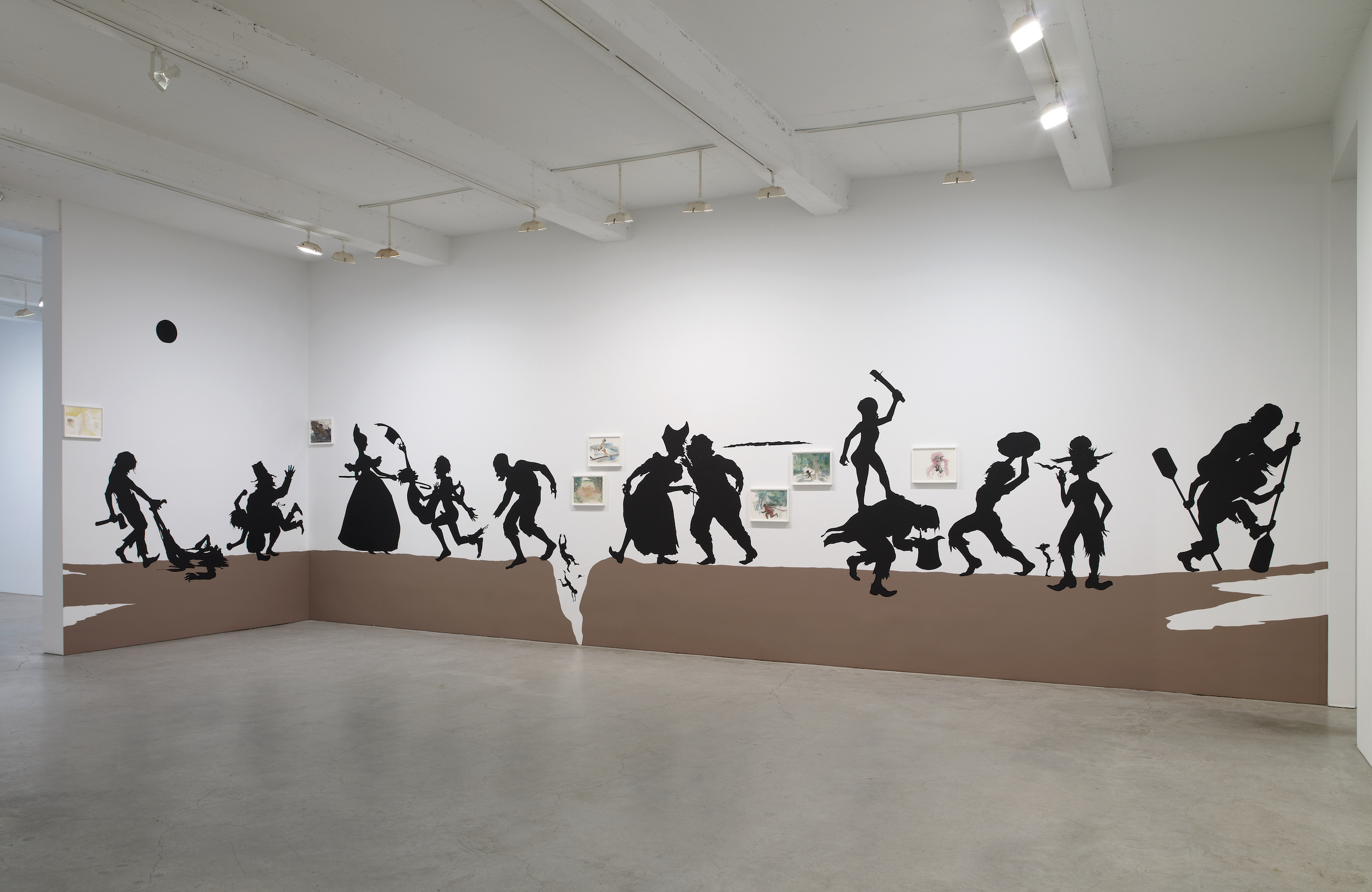 Kara Walker, The Nigger Huck Finn Pursues Happiness Beyond the Narrow Constraints of your Overdetermined Thesis on Freedom - Drawn and Quartered by Mister Kara Walkerberry, with Condolences to The Authors , 2010. Cut paper and paint on wall; gouache and ink on paper (framed). Installation approx. 144 x 576 inches. Works on paper, 7 parts: 11.5 x 15 inches.Photo: Jason Wyche