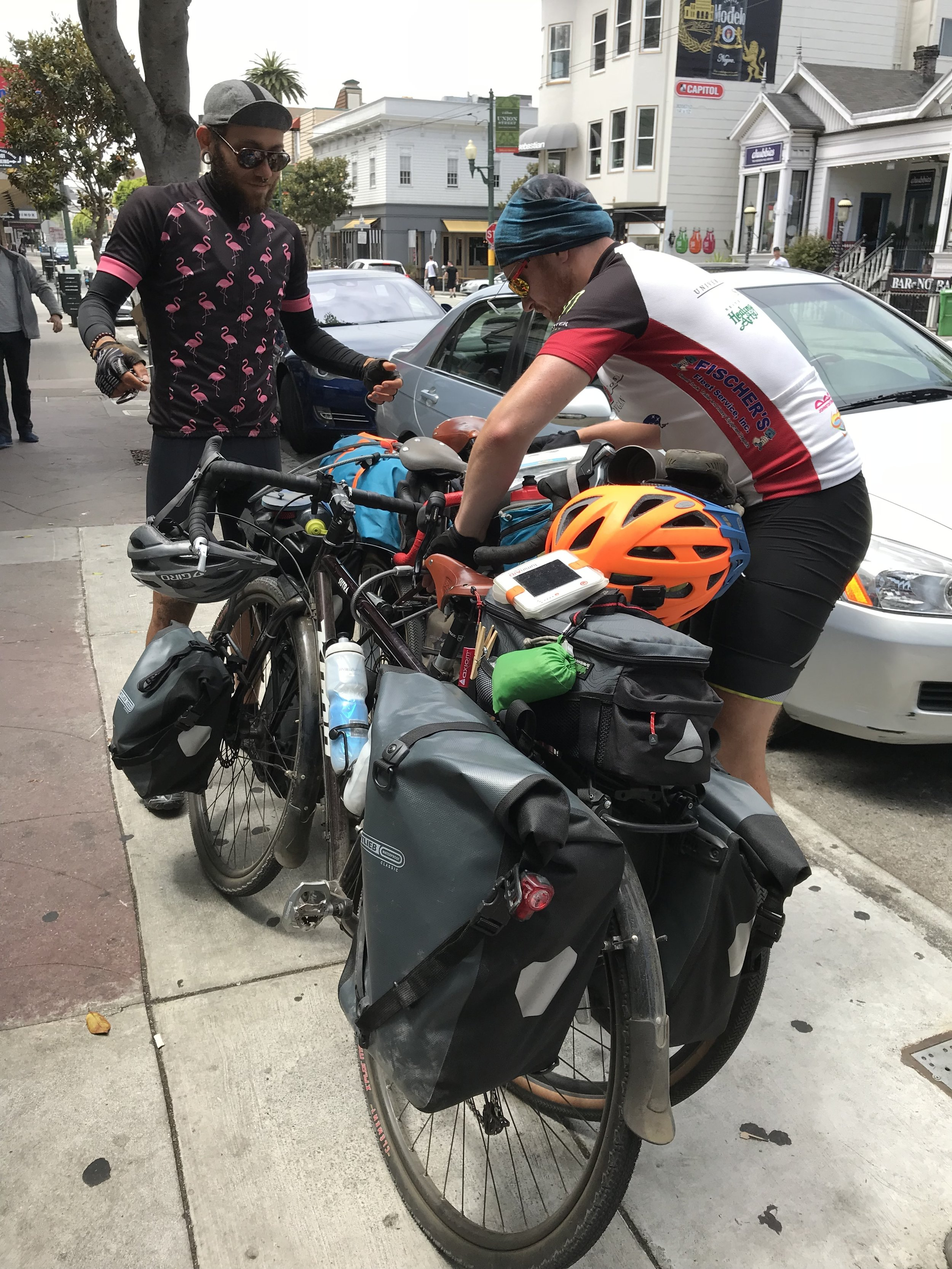Stopping for lunch in San Francisco and attempting to lock our bikes together.