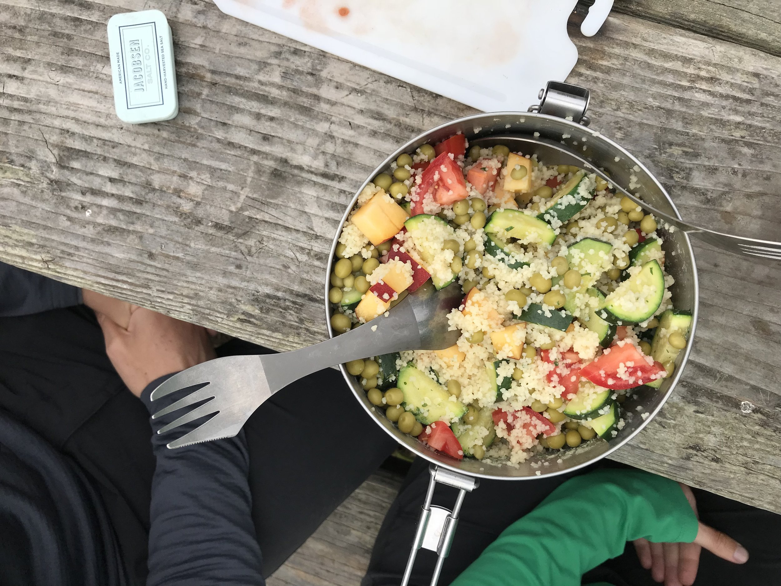 One of our camp meal specialities: couscous and veggies. Lots of carbs and quick to cook. Also, we have bowls, but we never use them—we have a communal pot.