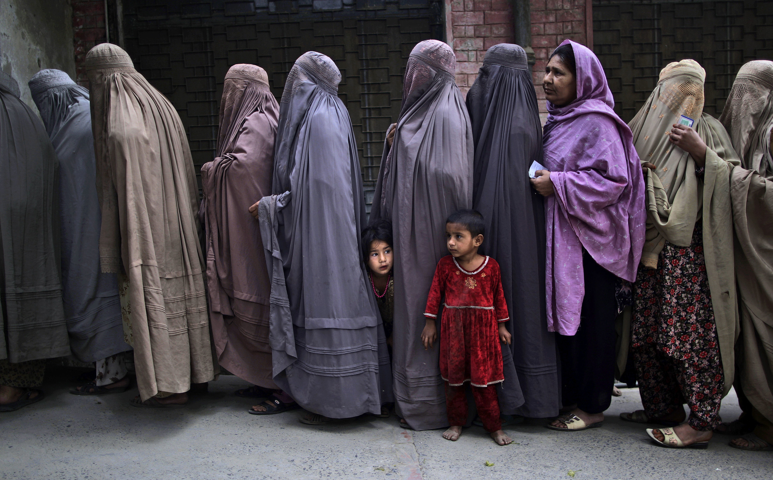 Pakistani woman line up to enter the polling station outside Islamabad, Pakistan (photo credit: AP)
