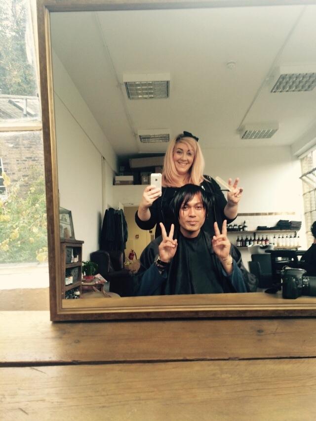 Me cutting Jun's hair