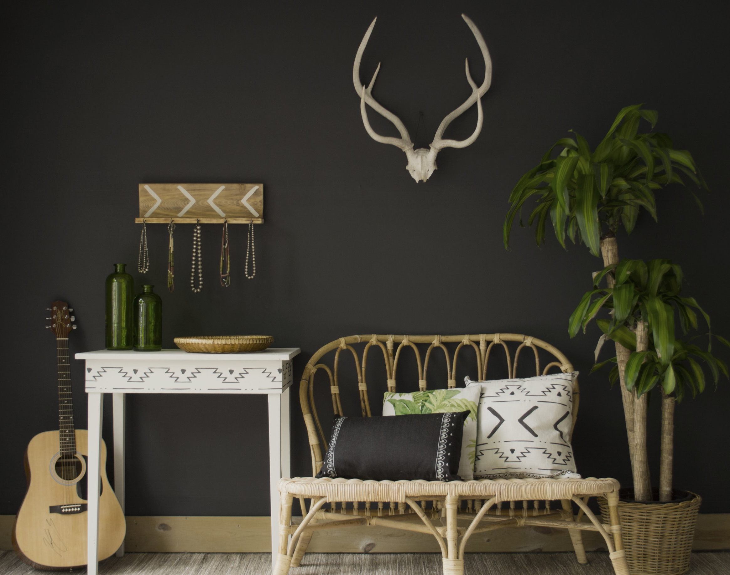 "Wall, table, black and white pillows, and jewelry rack made with stencil, sprayer and heat gun.   Wall color Benjamin Moore ""Onyx"""