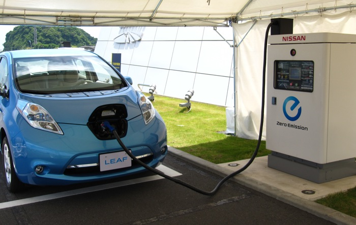 A Nissan LEAF electric car plugs into a DC Fast Charging station. Stations like this can add 80 miles of driving range in about 25 minutes.