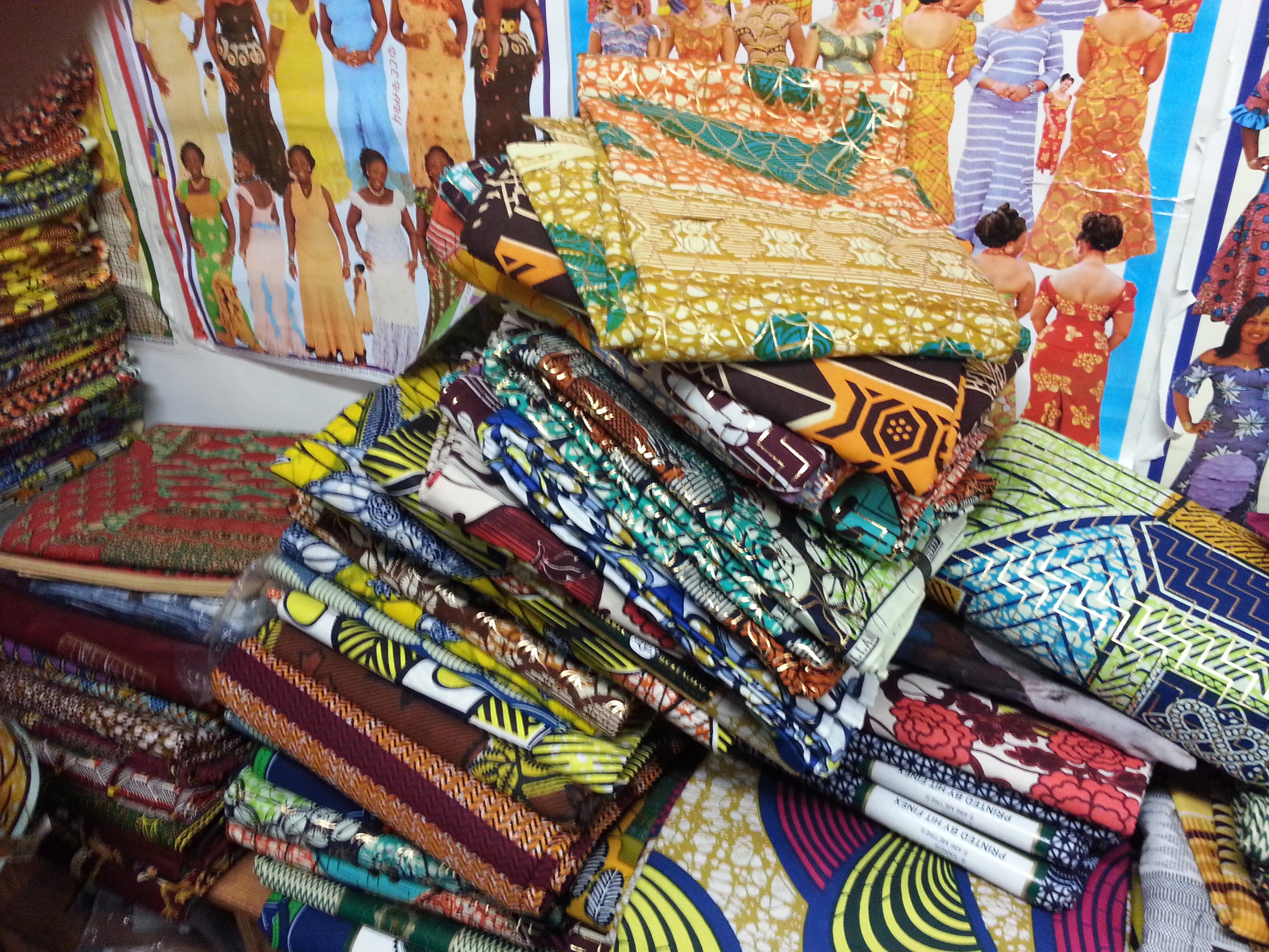 A pile of Vlisco prints at a Jane and Wilson shop