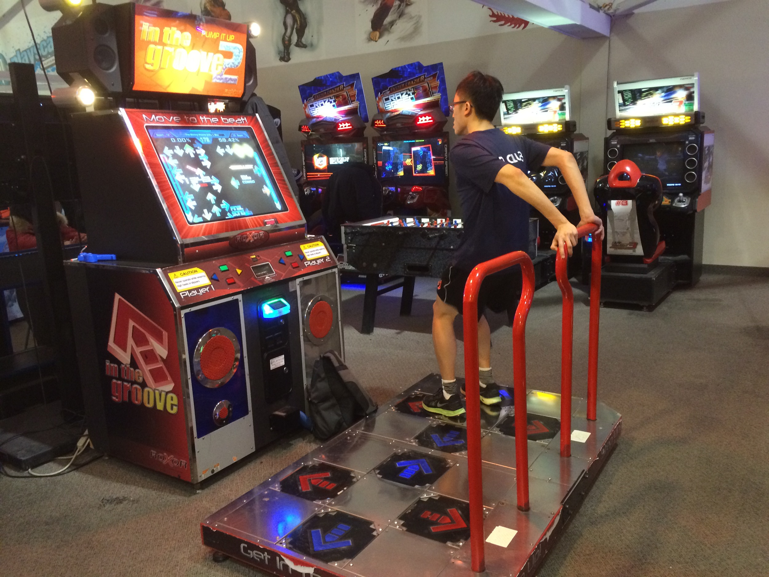 Teen practicing his dance skills at Playscape, the arcade on the second floor at Pacific Mall