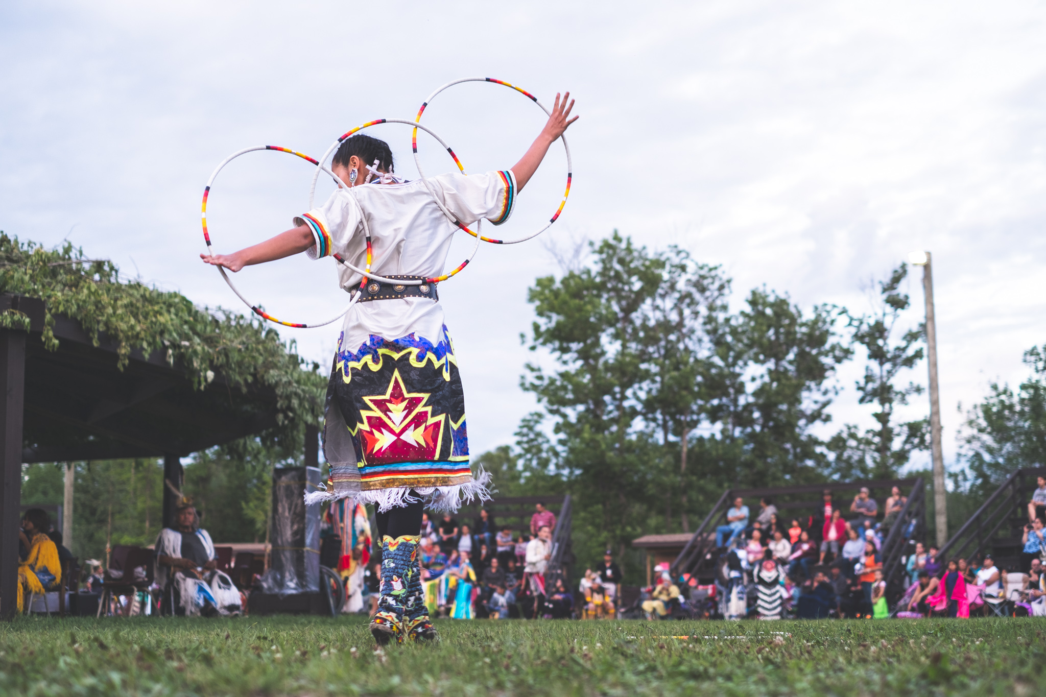 Shanley Spence, a hoop dancer and fancy shawl dancer living in Winnipeg, Manitoba, performs at the Eagle Lake First Nation Powwow