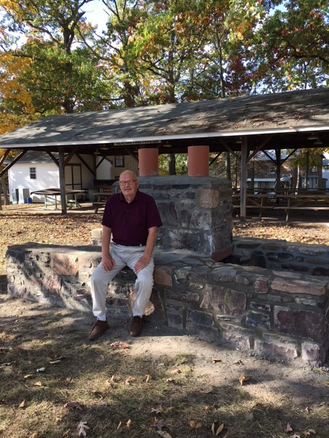 Cottage owner, Larry Landes, admiring the restoration of the Fireplace, at the Pavilion.