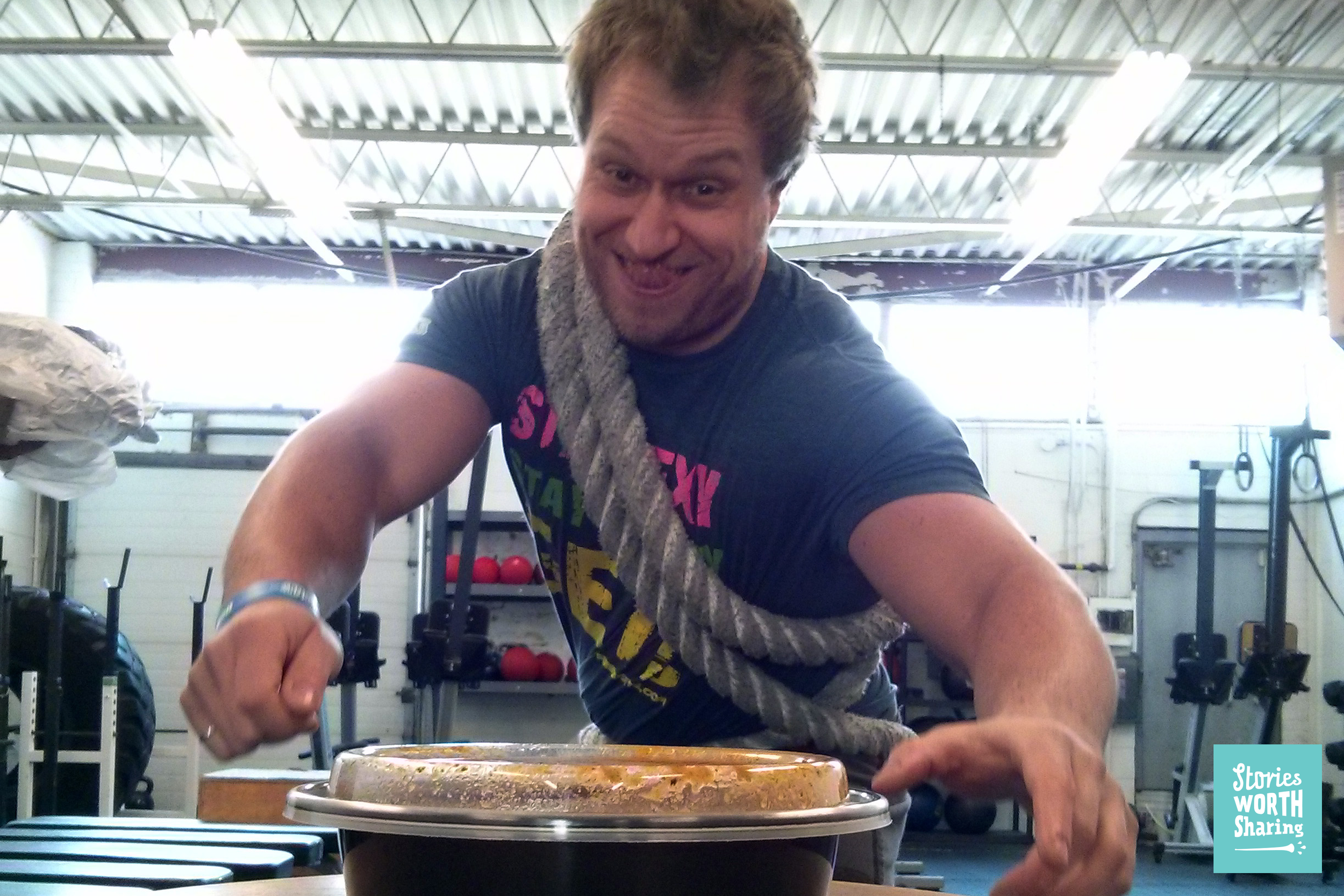 Furious Pete tied down with rope, as he tries to dip naan into some curry