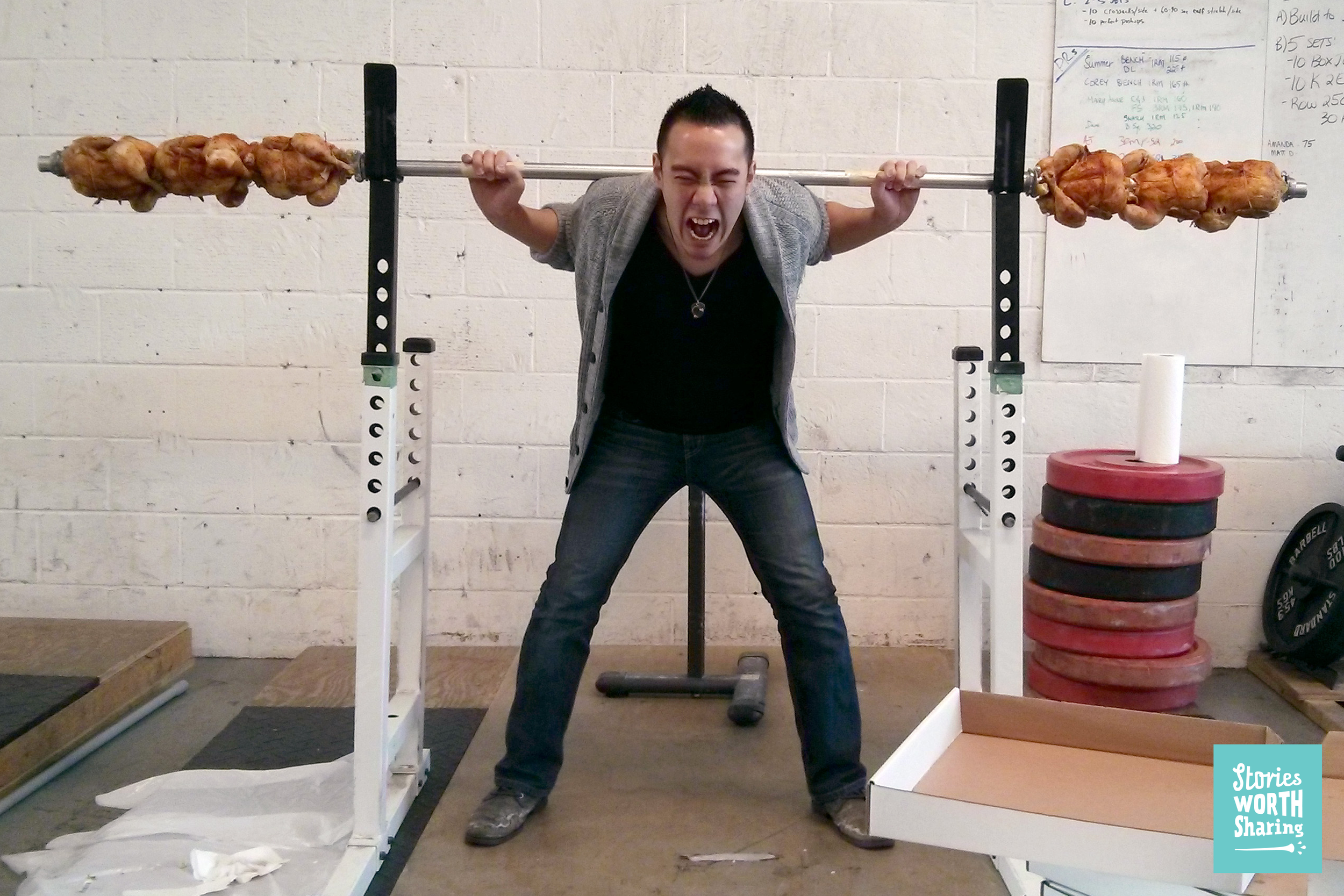Our creative director, Chun, lifting six rotisserie chickens on a barbell