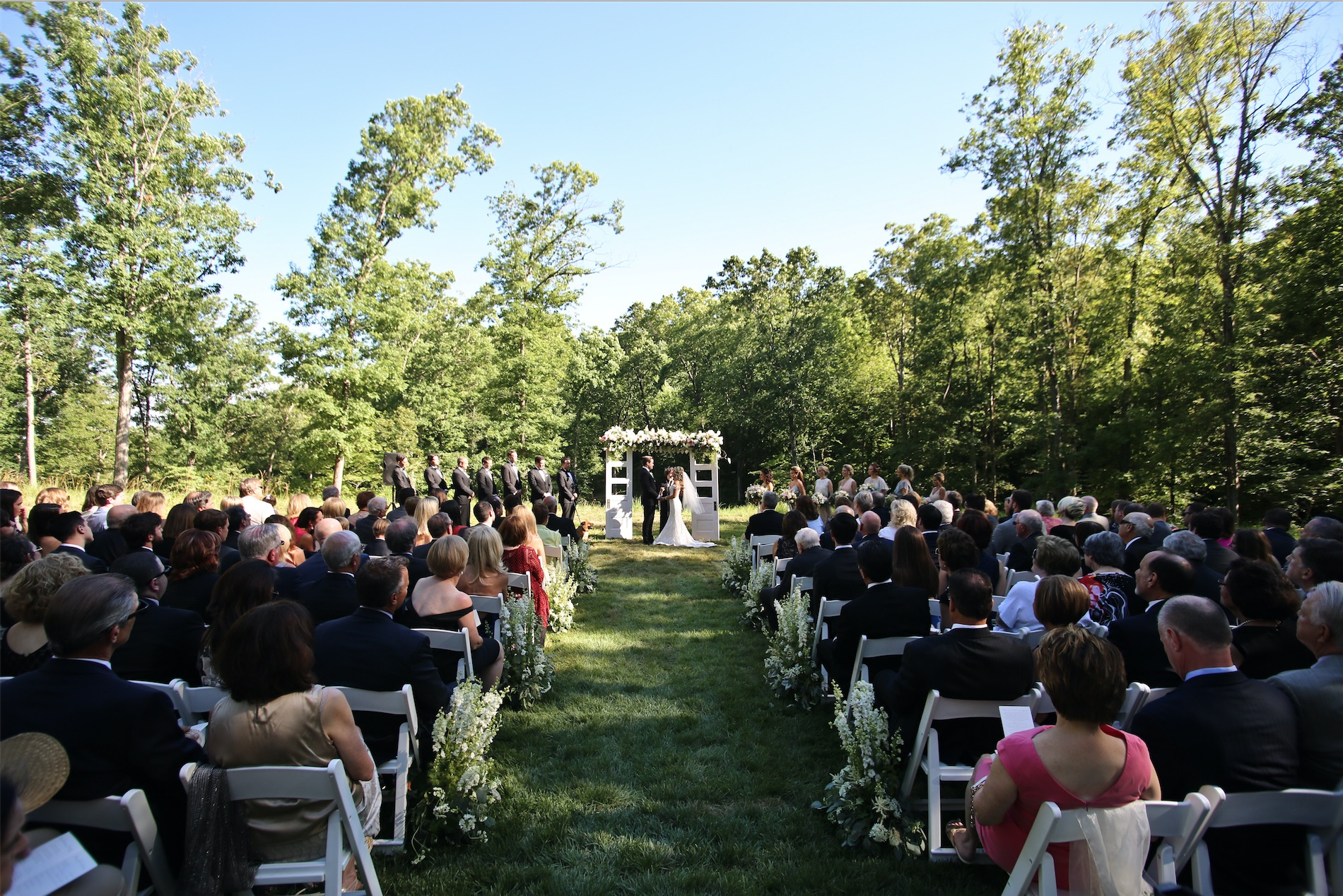 "the meadow - Our meadow is truly the hidden gem of all ceremony locations! For those seeking something off the beaten path, look no further. Take a walk down our trail, down your aisle, and say ""I do"" completely surrounded by Missouri woodland. Approx. total chairs: 260 with 9 rows.*Please note the meadow is only accessible by trail. Silver Oaks Chateau does have one golf cart available for rent, though you may consider renting additional means to transport your guests.*Utilizing the meadow will add an additional $400 to your rental"