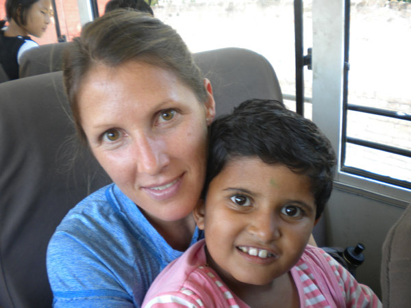 Taking a busload of excited orphanage children on a rare field trip to Kathmandu.