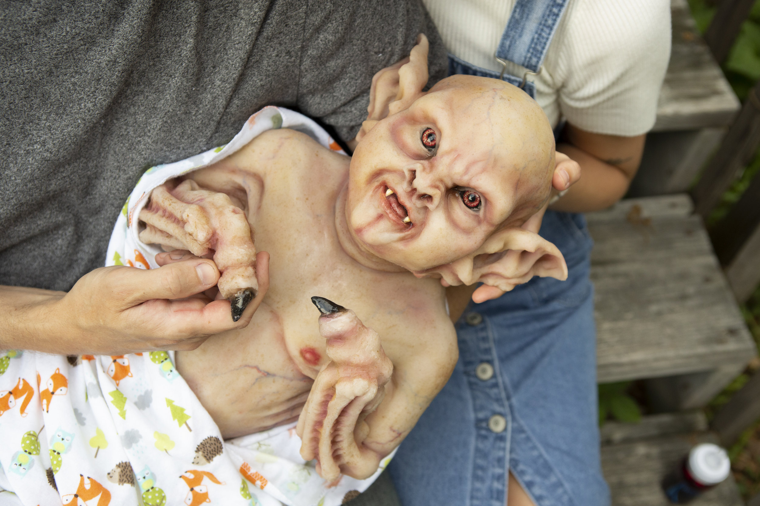 In Daddy's Arms | Newborn Vampire  | Newborn photoshoot | Ravendark Creations Vampire Baby | Newborn Photoshoots | Alyssia Booth's Candid & Studio | www.abcandidstudio.com