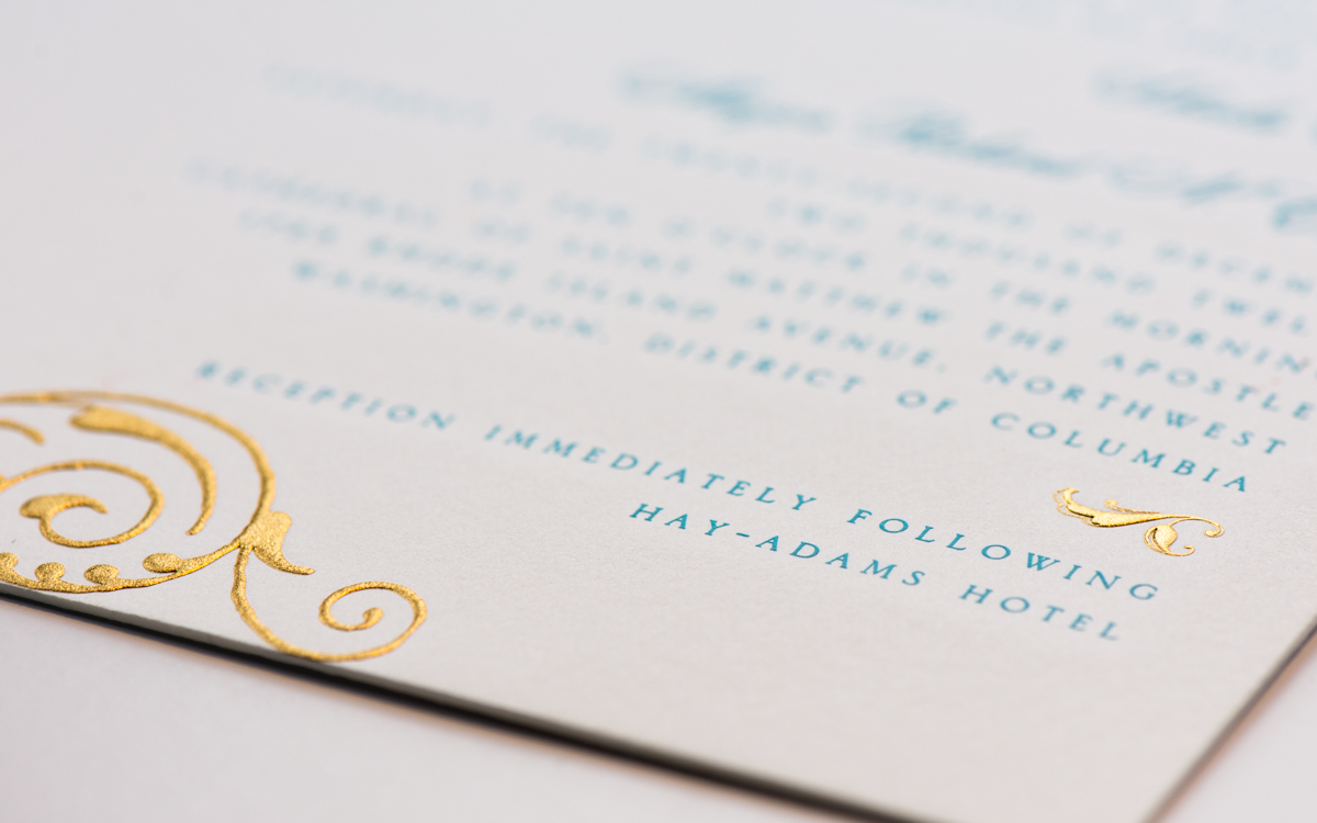 gold embossed embellishments on letterpress invitation
