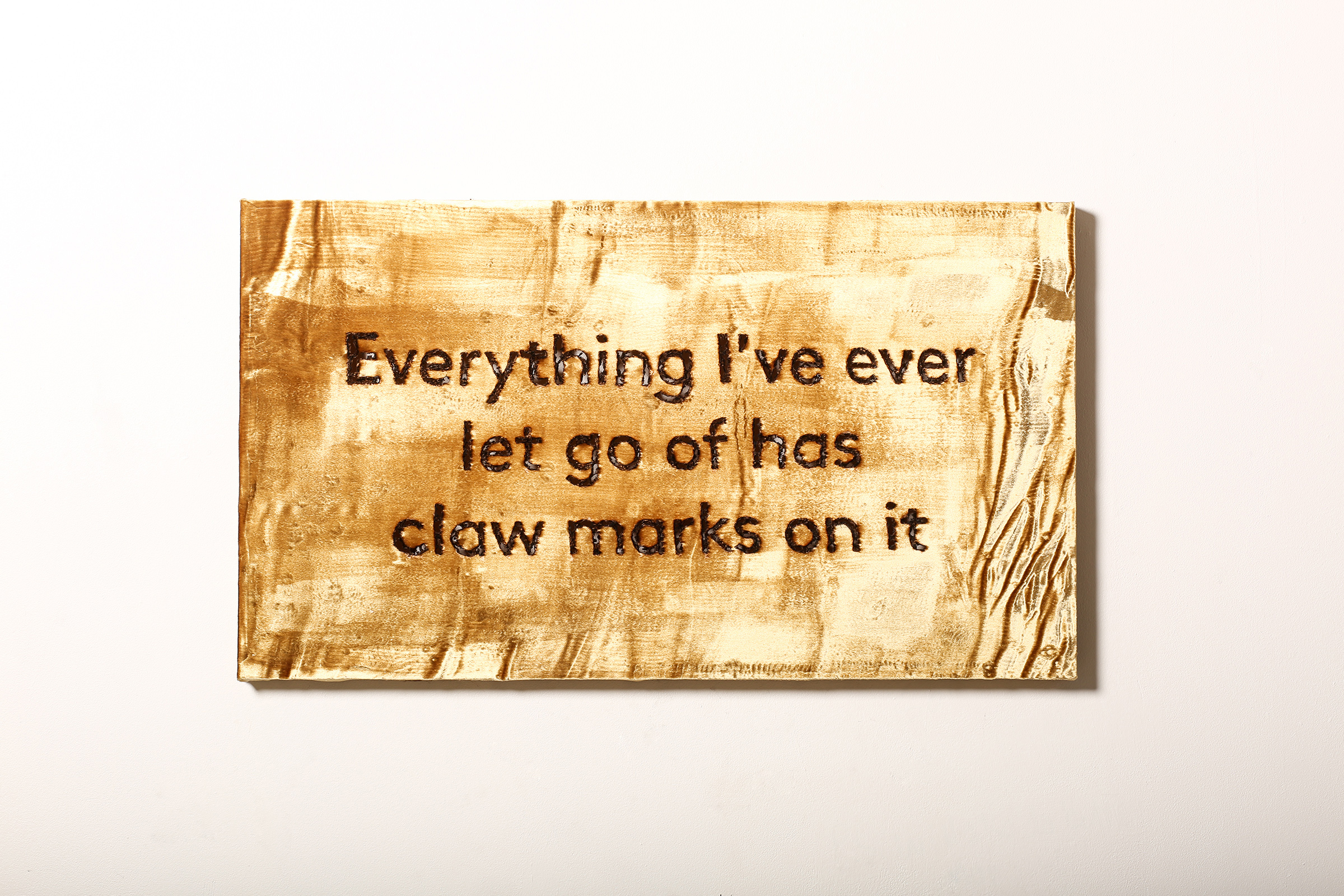"""Everything I've ever let go of has claw marks on it  Hand burnt text on silk velvet   42"""" x 24""""   2016"""