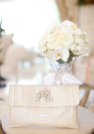 real weddings_jen and rud_small python clutch.jpg