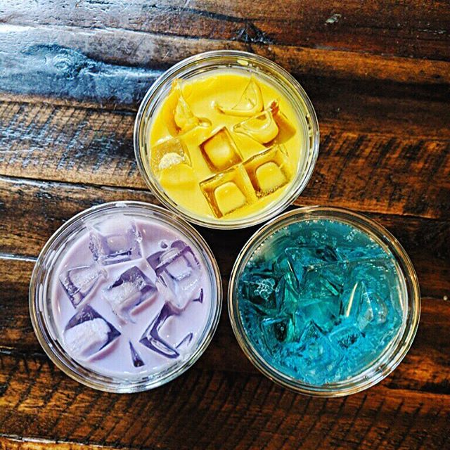 Meet three #colorful new additions to our summer menu! (clockwise from top): #GoldenAgaveLatte, served with your choice of alternative milks... #OceanSpritz, an effervescent coconut and lime soda drink... and the #UbeLatte, made with an #ube-based syrup (Ube is a Filipino purple yam)! #💛💙💜