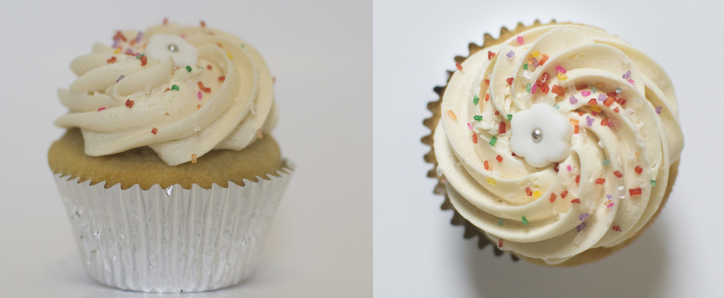 Vanilla  - Our moist vanilla cake topped with vanilla buttercream, sprinkles, and a white fondant flower topper.