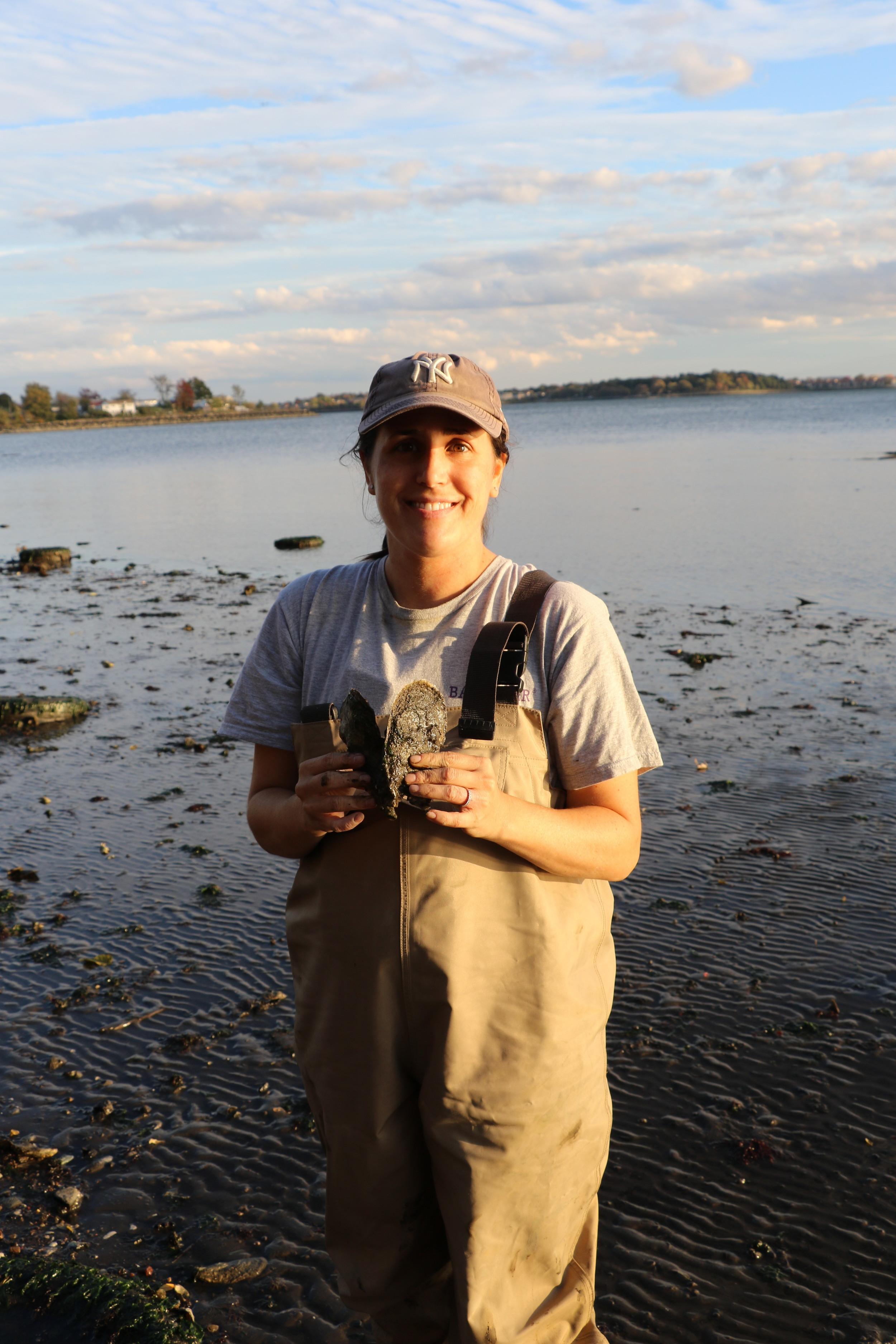 Dr. Allison Fitzgerald of NY/NJ Baykeeper shows a huge oyster from the natural reefs, Photo Credit: Liz Summit, 2015