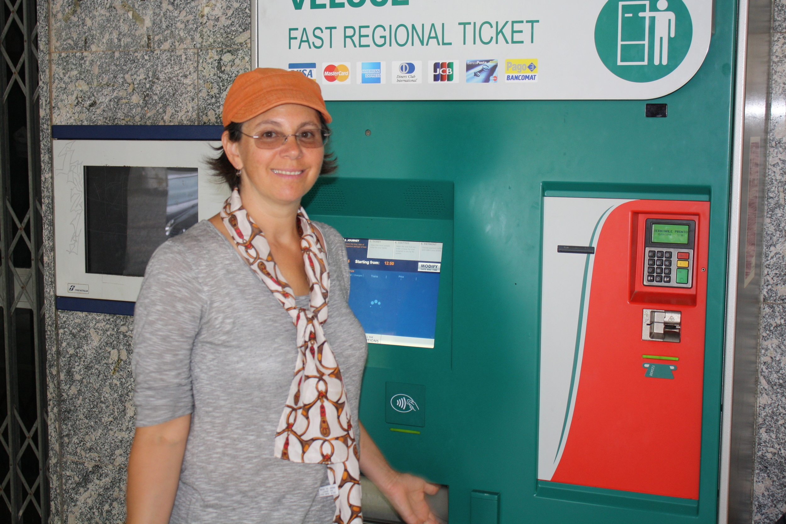 My mom in front of the ticket machine that took 30 minutes to work.