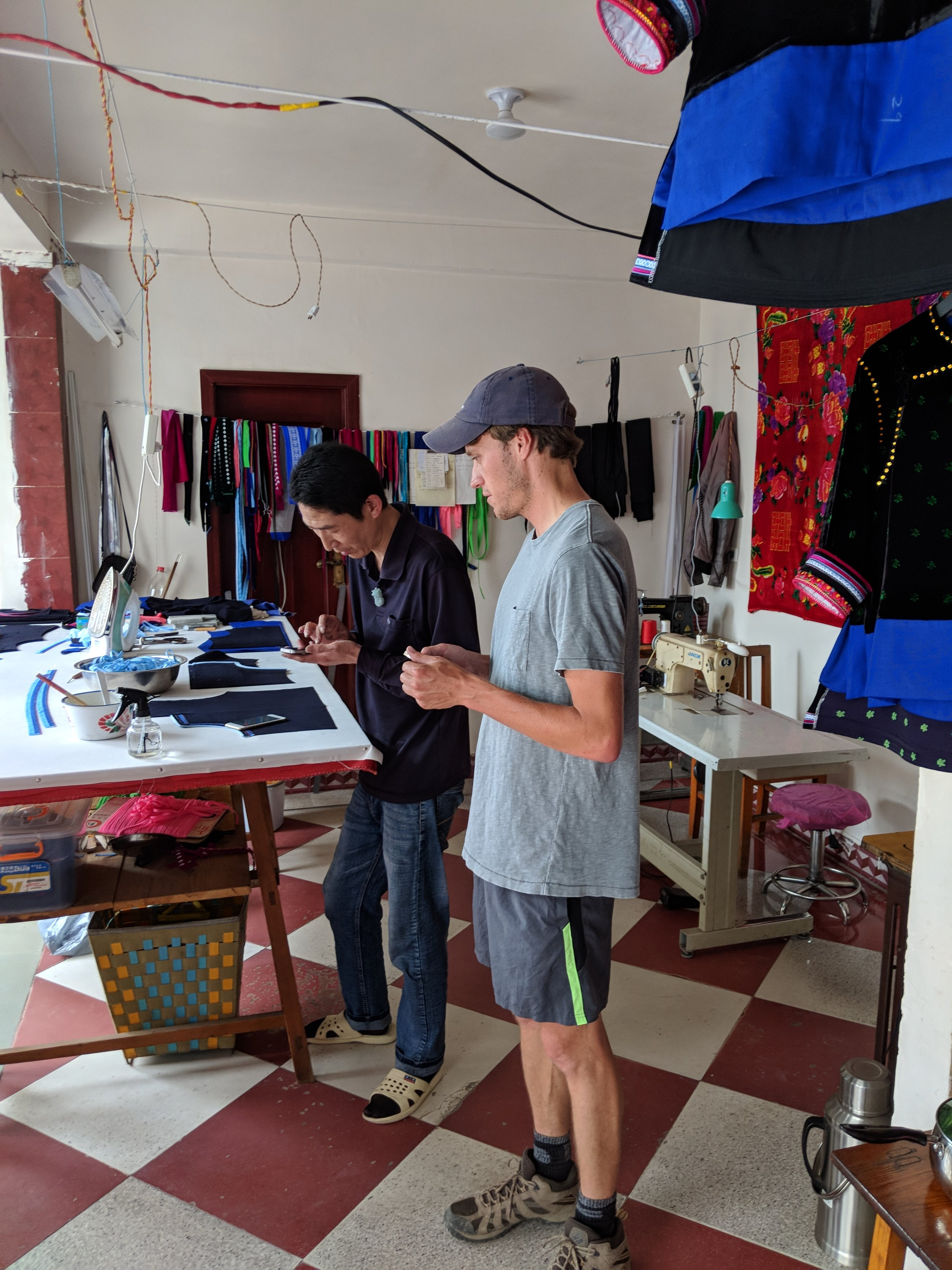 Alex asked for directions at a shop selling hand-made Bai clothing, which many locals still wear.
