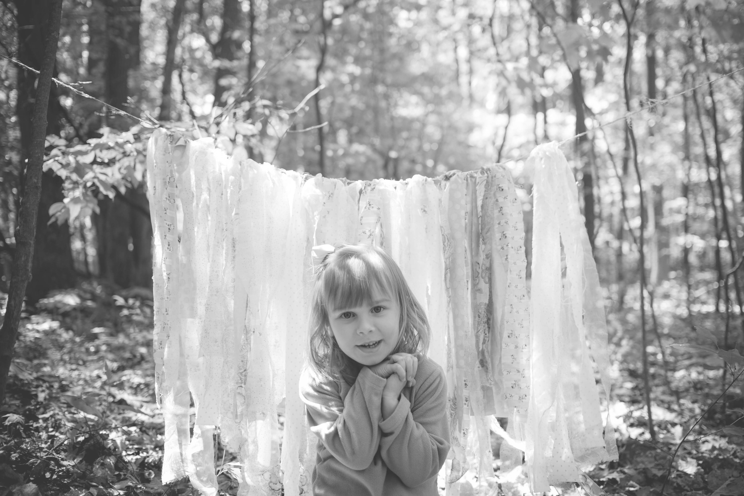 So, I made this cute little ribbon backdrop that I thought would be so cute for Sydney's photos, but by the time we got it up, the girl was DONE. Luckily, big sister Charlotte was ready for her close up!