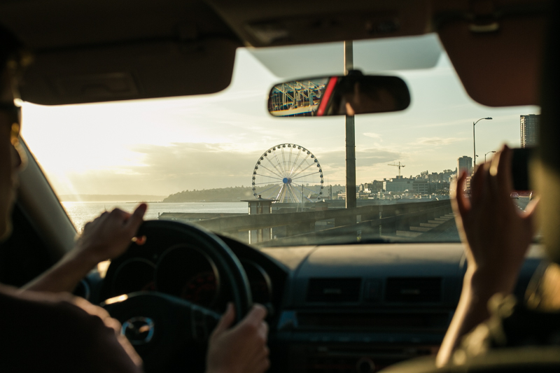 "The drive into Seattle, Seattle's ""Great Wheel"" on the Horizon."