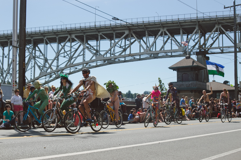 Naked bike riders underneath Fremont's bridge (the one with the troll!).
