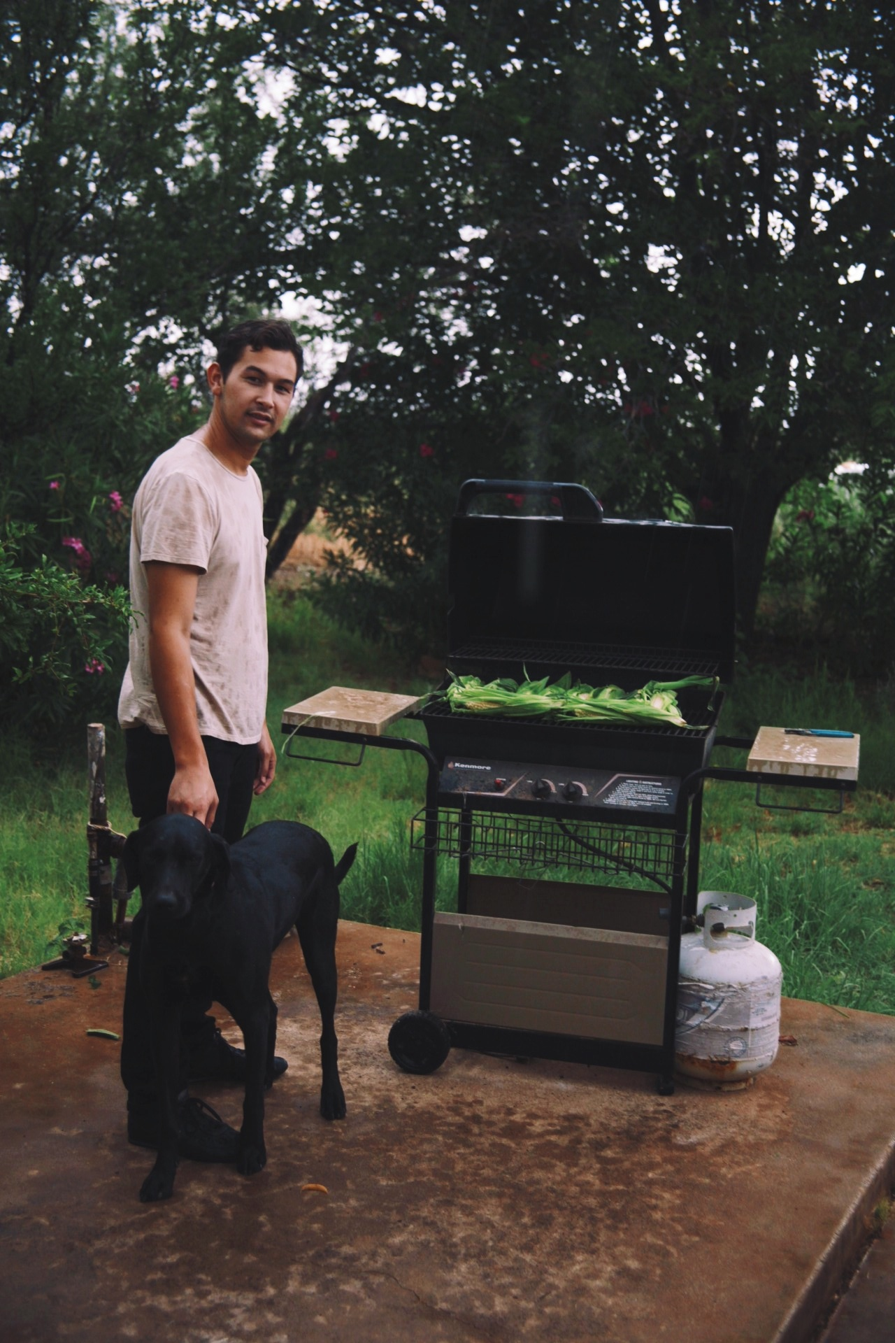 BBQing in the rain with my dog Chuck.
