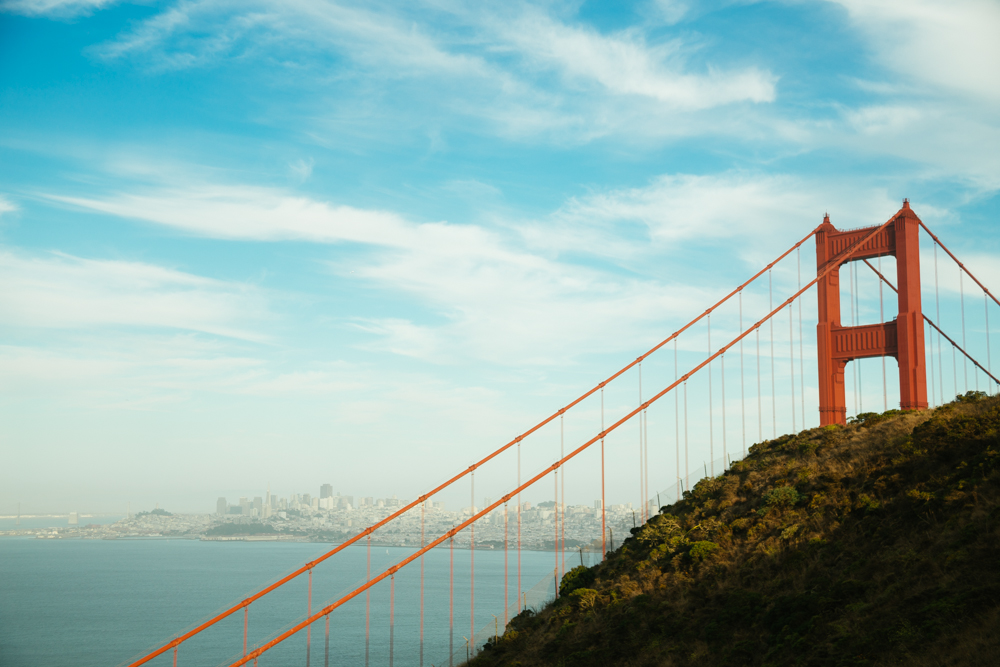 The bridge peeks out from behind the hills of the Marin Headlands