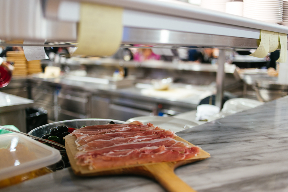 Freshly sliced prosciutto in  EATaly's fresh meat and cheese area