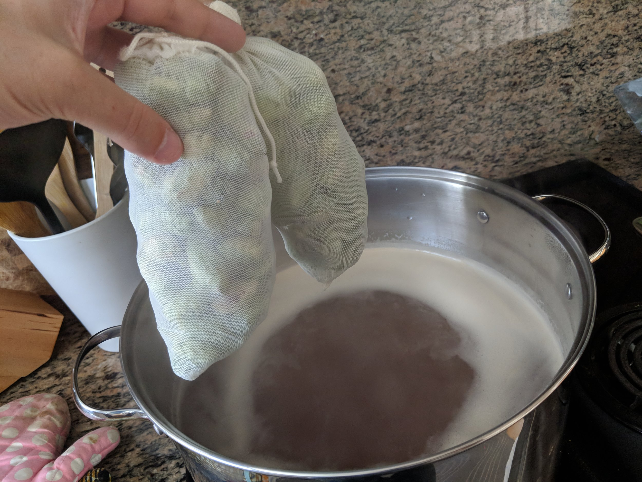 Add hops. These mesh bags aren't necessary but make removing the grains/hops easy.