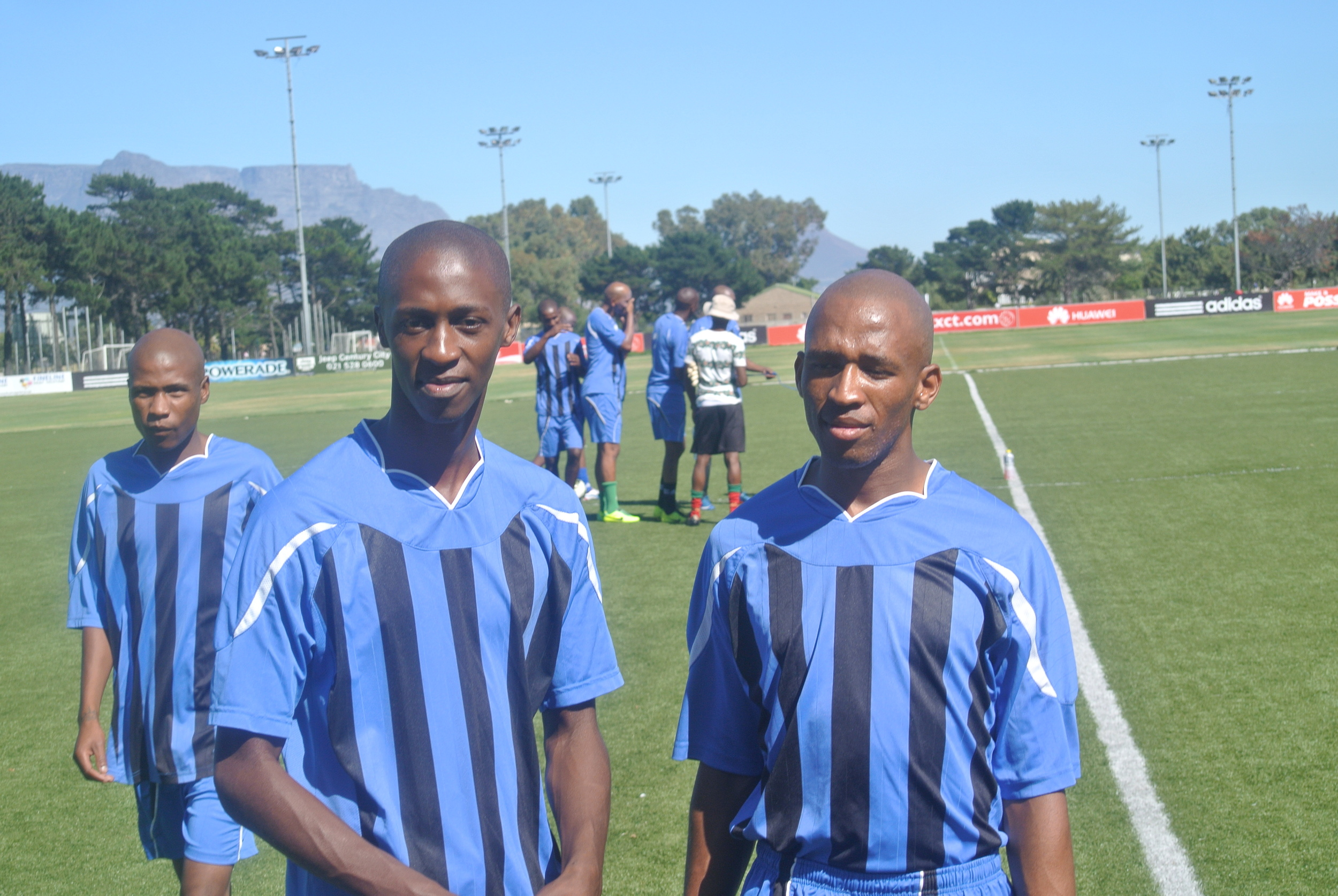 Warren, Vuyo and Xola (from left to right) getting ready for the big game.