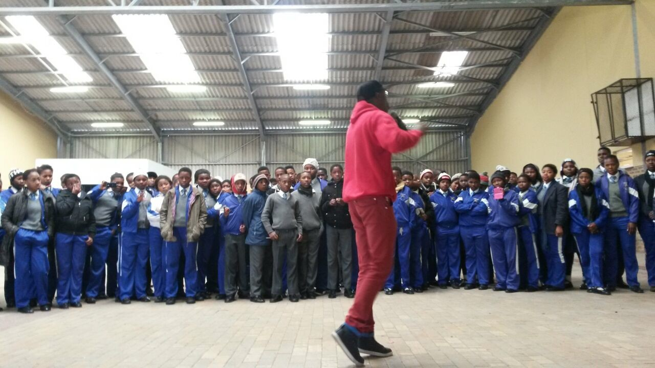 Vuyo Nyabaza speaking with local youth in one of Nyanga's biggest schools.