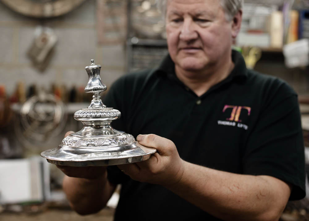 The FA cup is being restored, repaired and pollished after its t