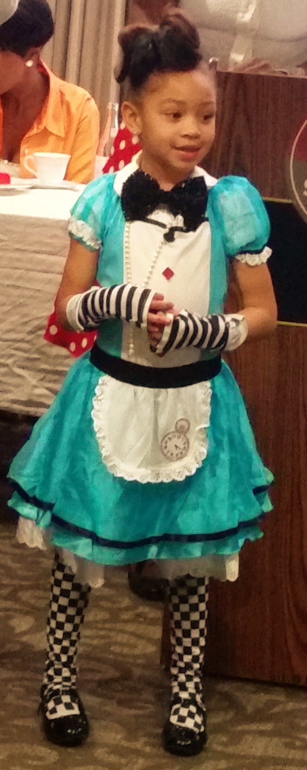 This cutie in the adorable blue tuxedo style dress is Savannah Banana, a five-year-old designer from New Jersey.