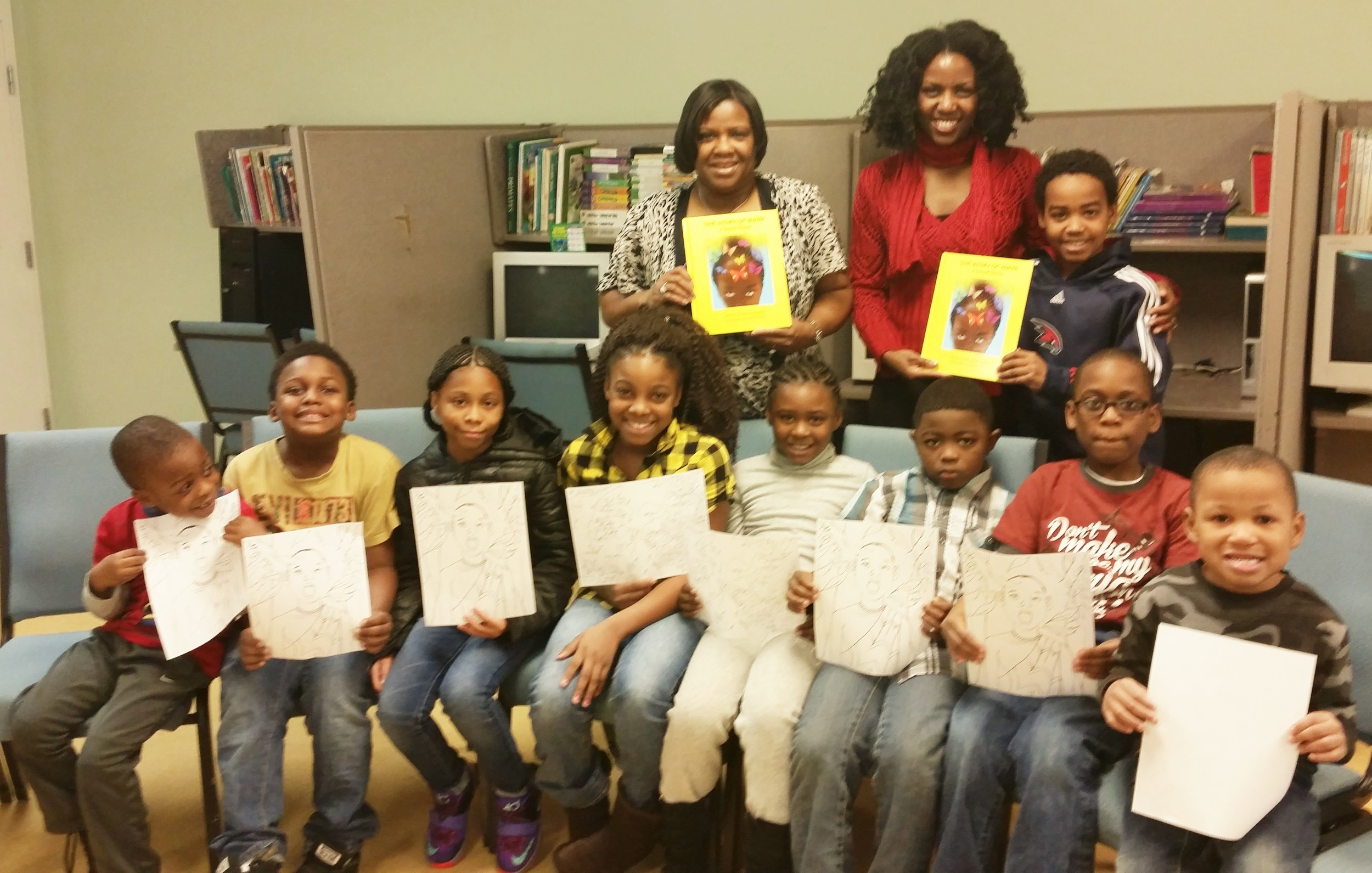 Say cheese!  Each child is holding a take-home coloring sheet of an illustration from the book.