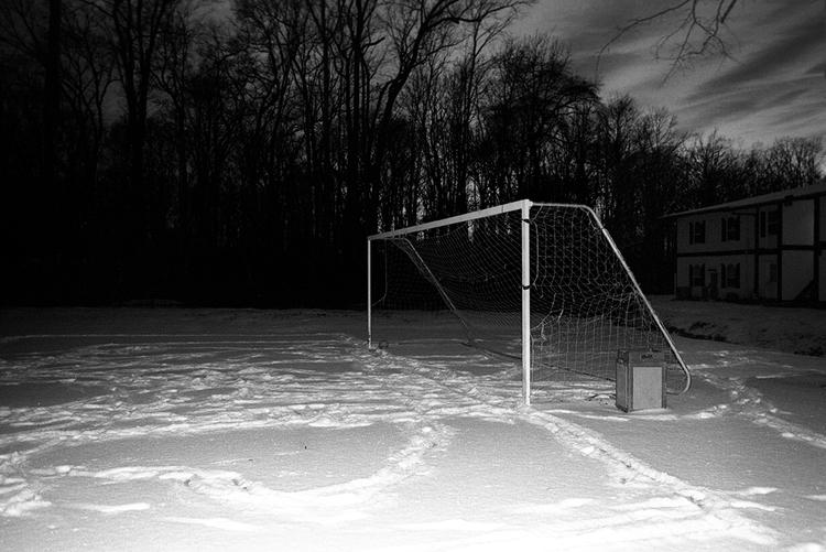 Soccer field on a snowy night, 2014.