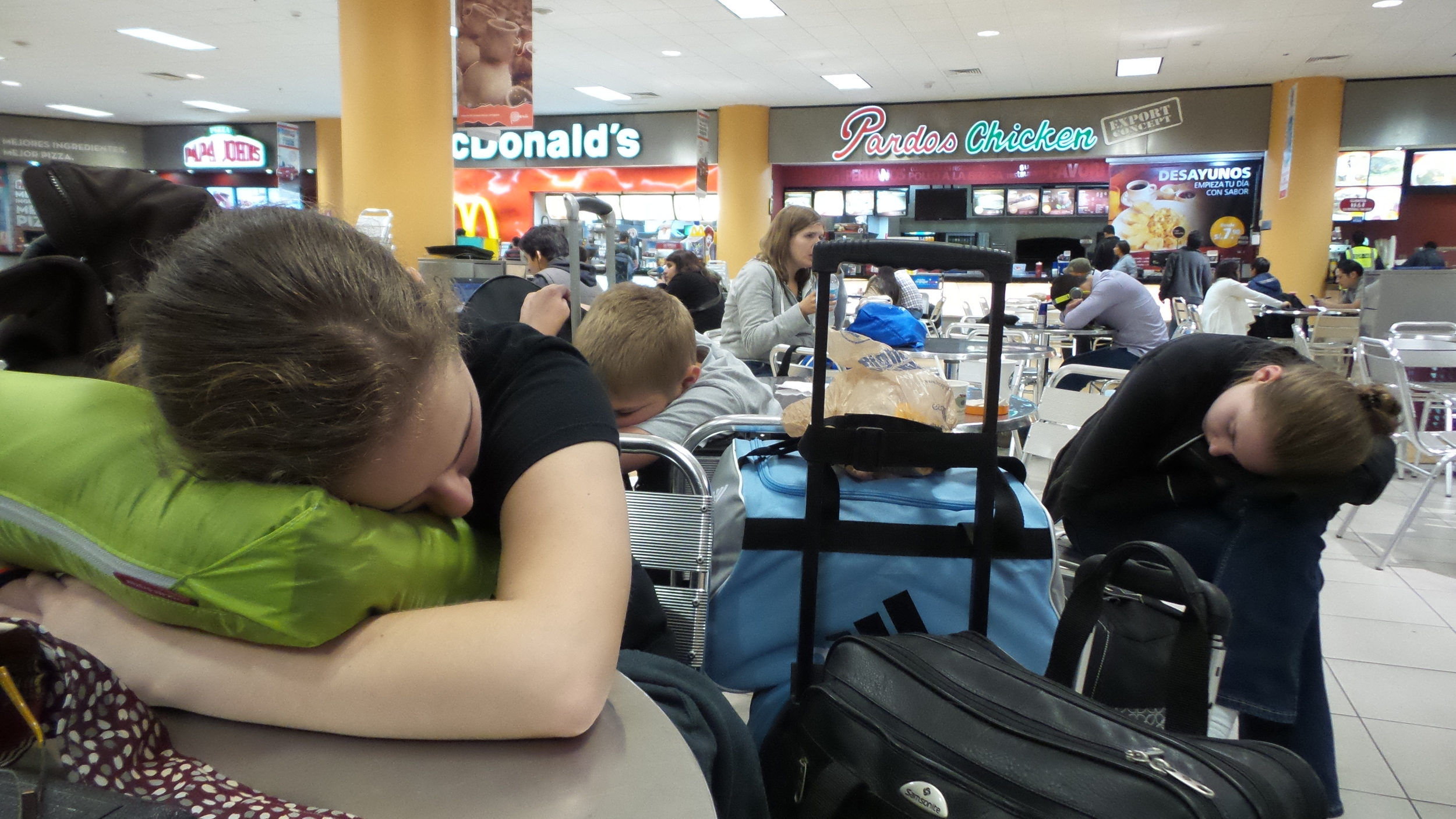 Out cold awaiting our next flight in Lima, Peru