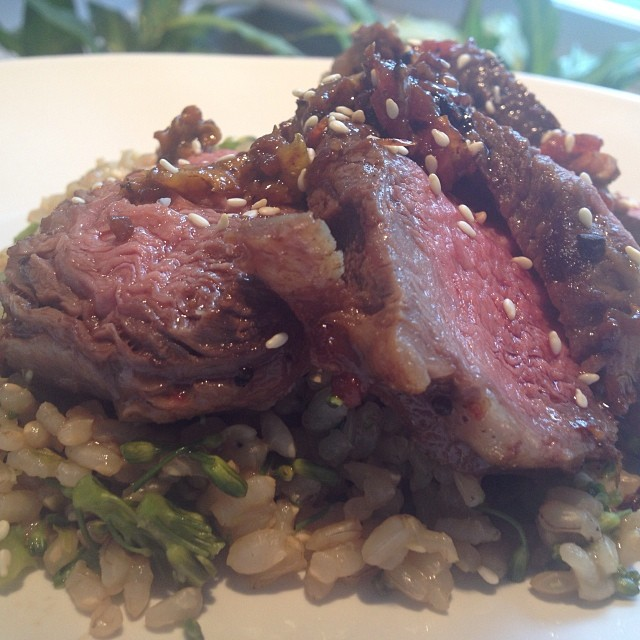 Beef and broccoli - ribeye over broccolini, bok choi and brown rice.  Marinated ribeye in soy mixture and cooked in sesame oil.  #empoweredwellness  #integratemorewholefoods