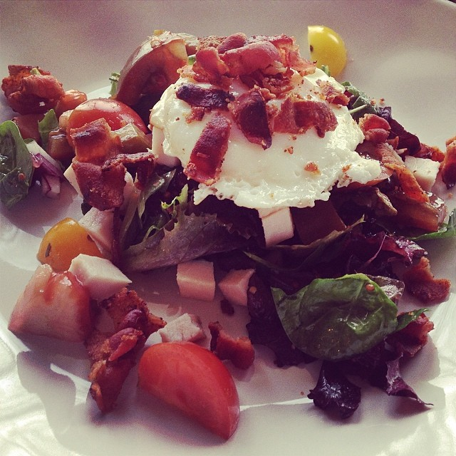 I'm from Pittsburgh, where everyone knows that any dish is better with an egg on it- I'm also from the Earth, where everyone knows that any dish is better with bacon!  Here is a simple heirloom tomato and turkey salad with eggs, bacon and my version of Gram's French dressing.  #empoweredwellness #integratemorewholefoods