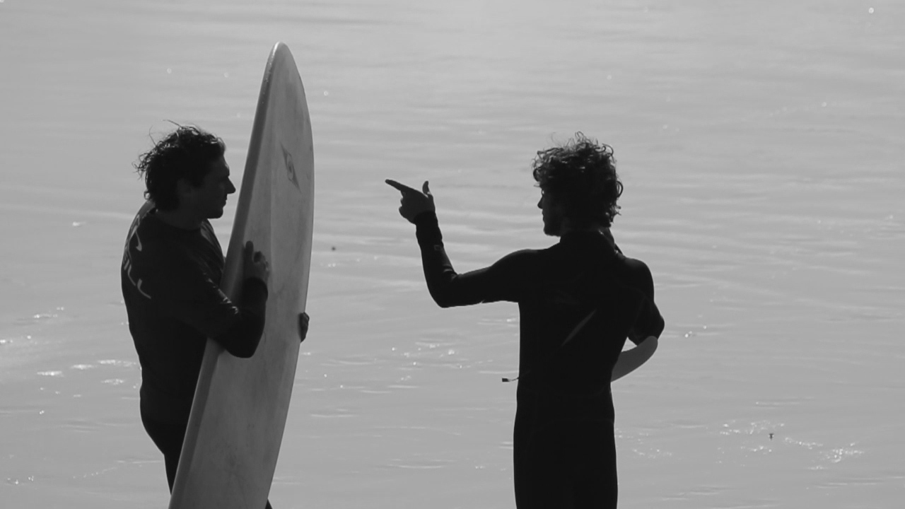 Ferg giving Colin a few tips on surfing before they head out.