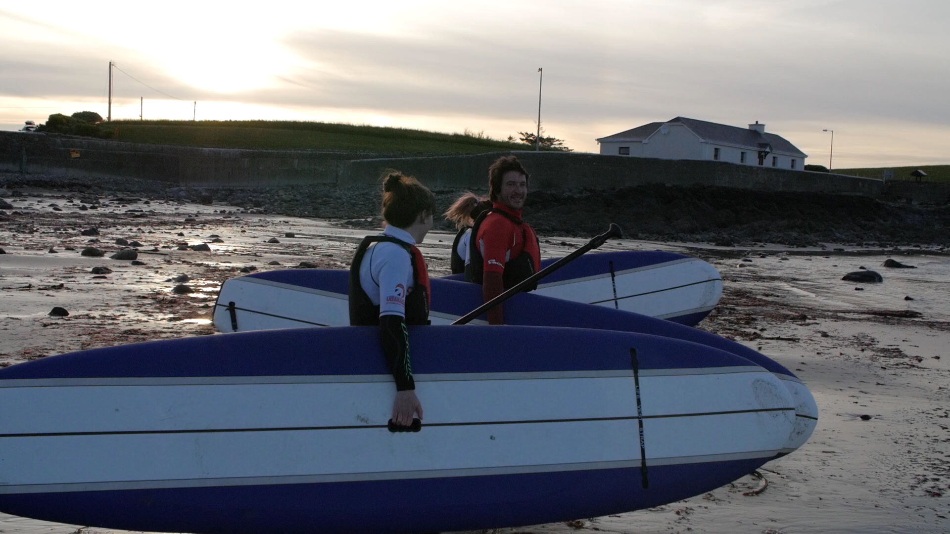 Andy, Breej & Ruby heading out for a SUP at sunset.
